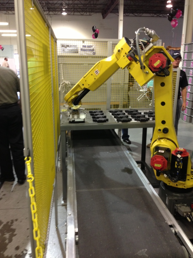 The robot can load and unload the parts. Who can program, set up, install, and troubleshoot the robot?
